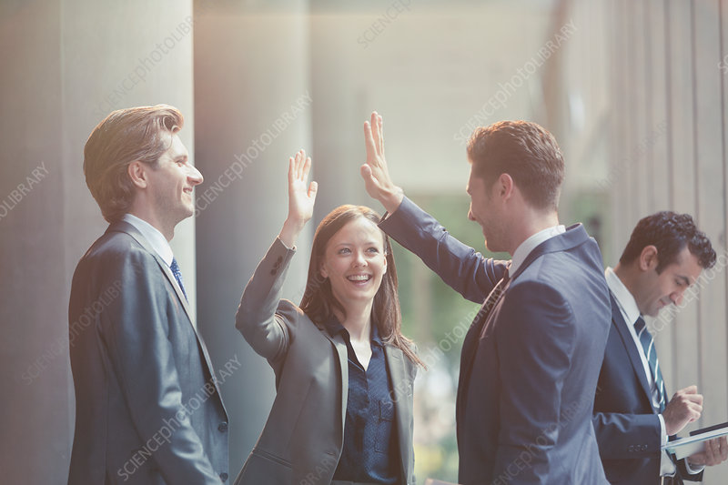 Business people high-fiving