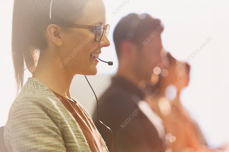 Female telemarketer wearing headset