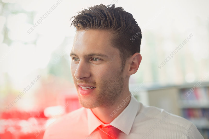 Close up brunette businessman looking away