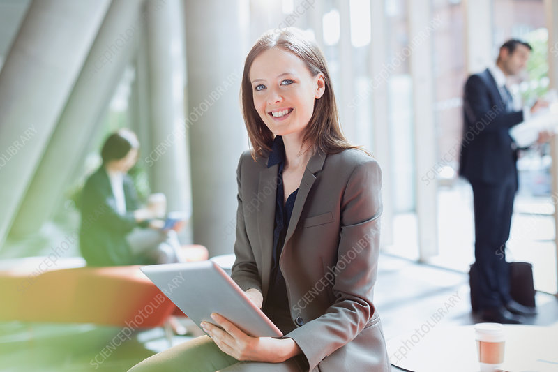 Portrait Businesswoman using tablet