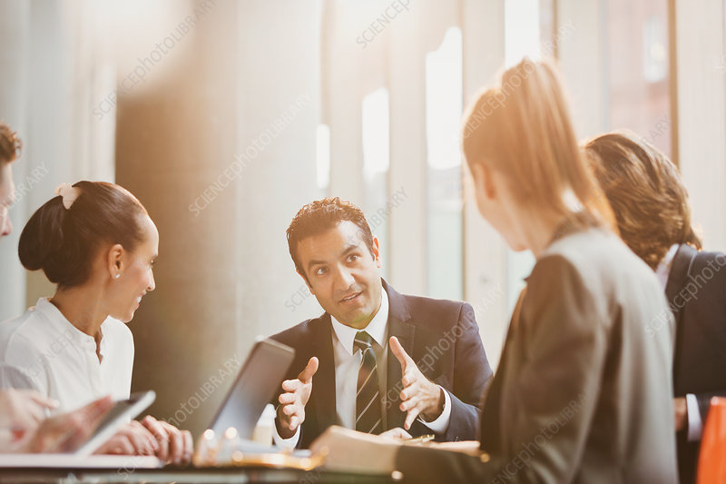 Businessman talking, leading meeting