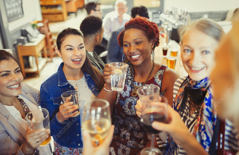 Women friends toasting wine and beer glasses