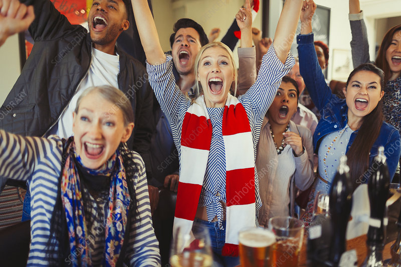 Enthusiastic sports fans cheering
