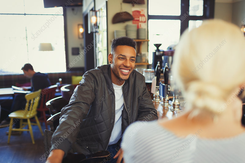 Man talking to woman in bar