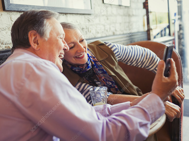 Smiling senior couple taking selfie