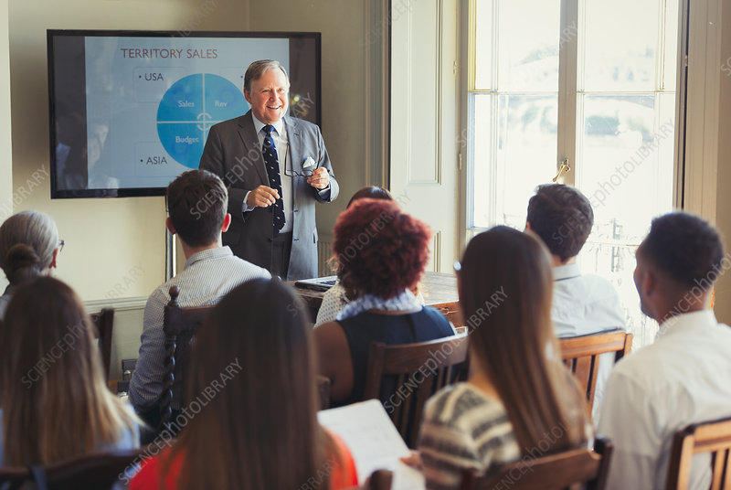 Businessman leading conference presentation