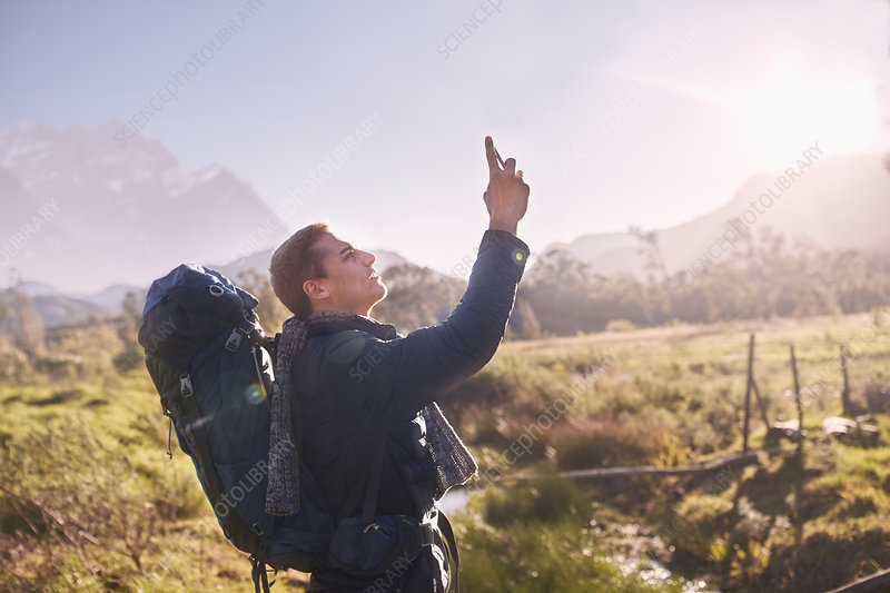 Young man with backpack hiking