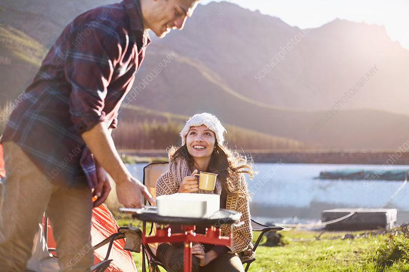 Young couple camping, cooking