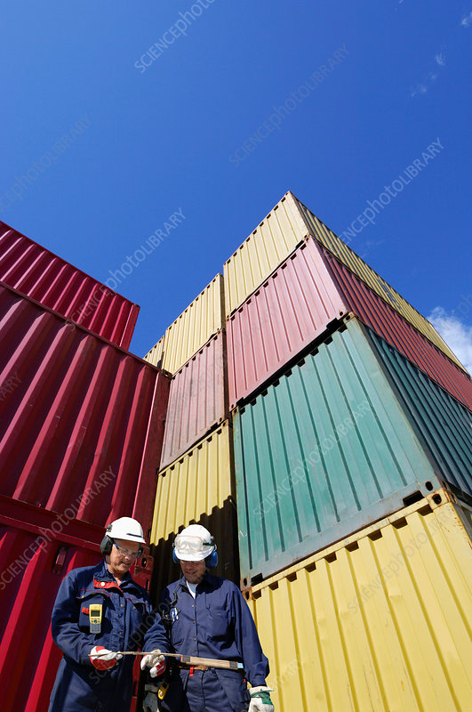 Shipping workers with cargo containers