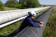 Worker checking gas pipeline