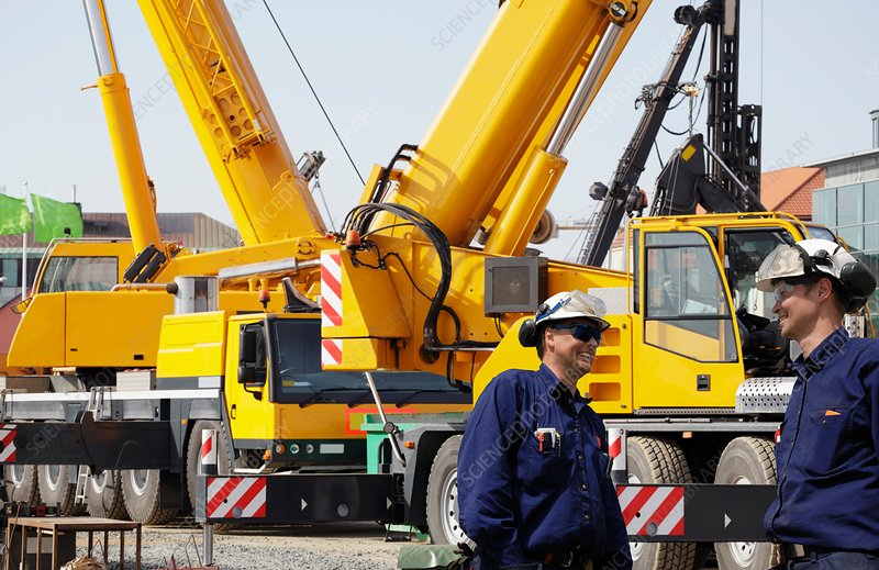 Workers on site with construction vehicles