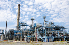 Oil refinery with pipework and chimneys