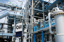 Oil refinery with pipework and sign