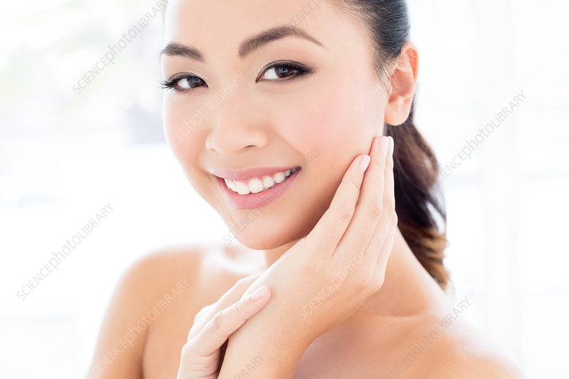 Woman with hands touching face