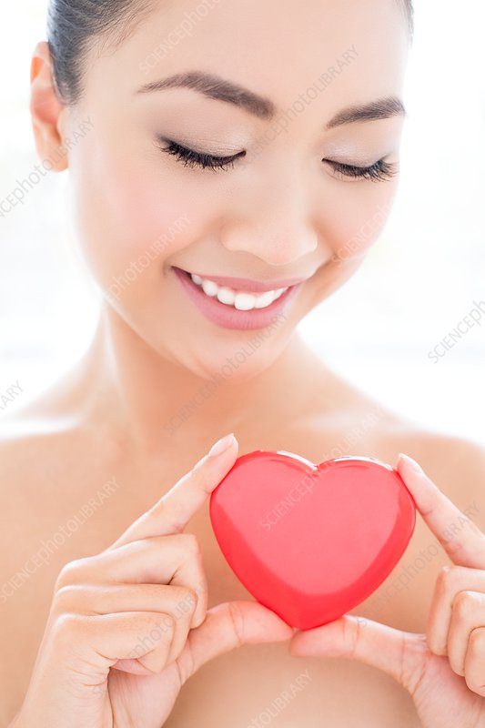 Woman holding heart