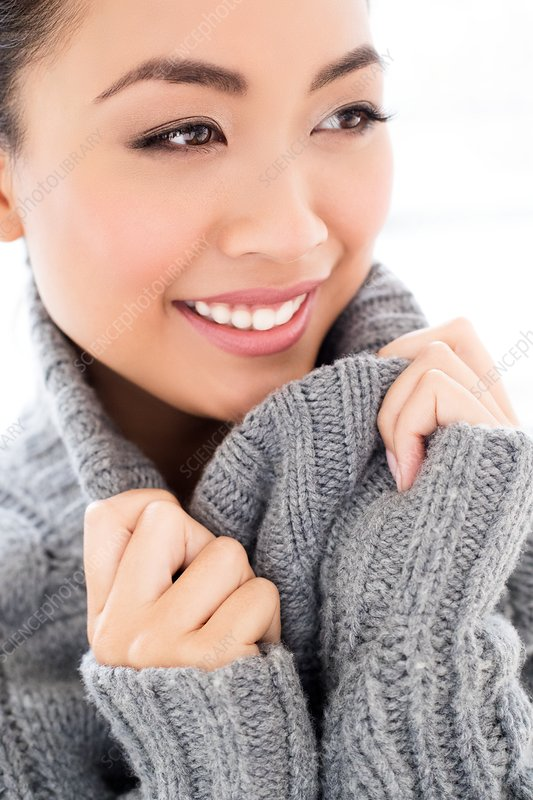 Woman wearing grey knitted sweater