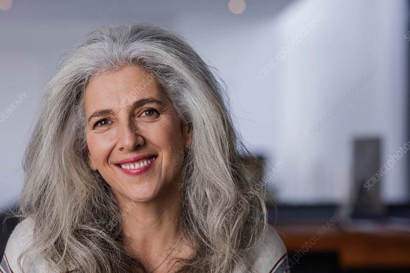 Portrait smiling mature woman with long, grey hair