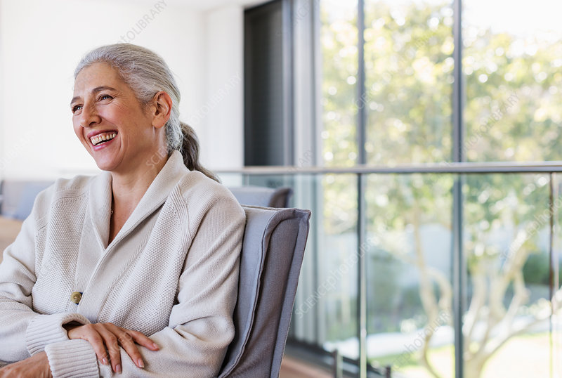 Mature woman laughing, looking away