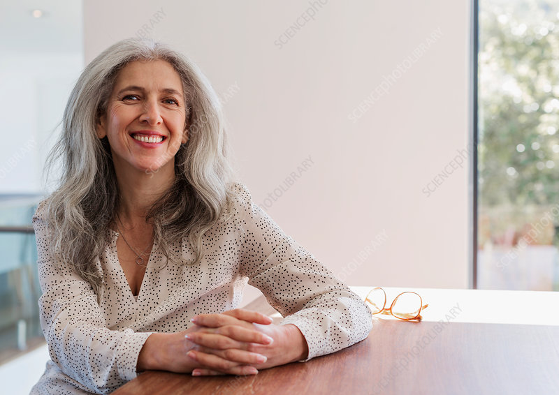 Portrait mature businesswoman sitting at table