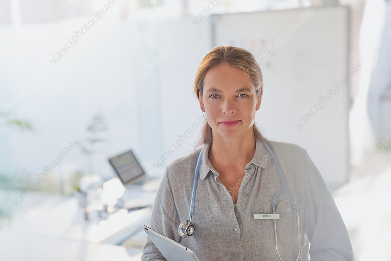 Portrait female doctor with digital tablet