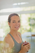 Portrait smiling woman drinking juice smoothie