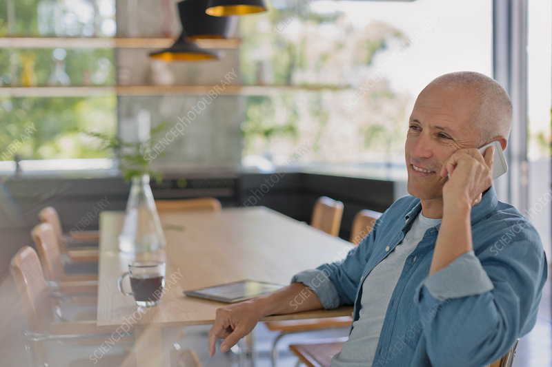 Smiling mature man talking on cell phone