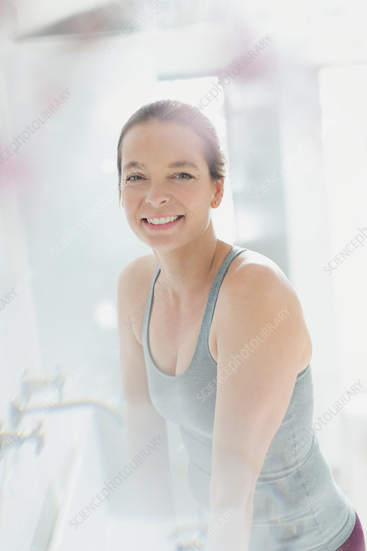 Portrait smiling mature woman in bathroom