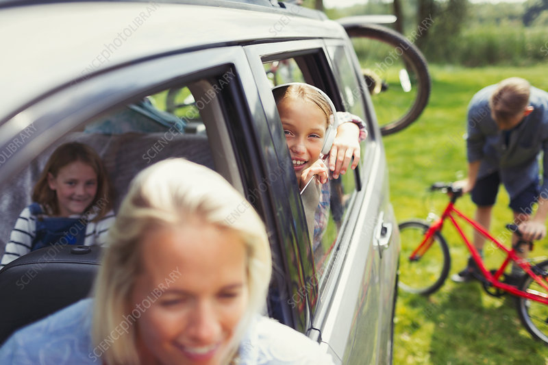 Portrait girl with family inside car