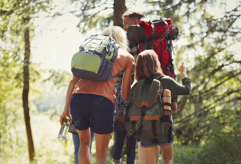 Family with backpacks hiking