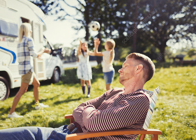 Serene father resting in lounge chair