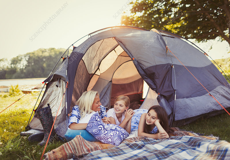 Mother and daughters talking and relaxing in tent
