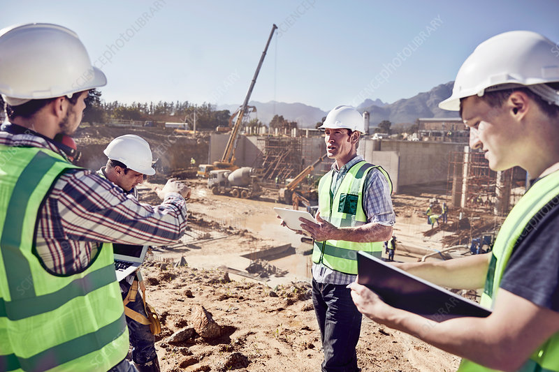 Construction workers and engineers meeting