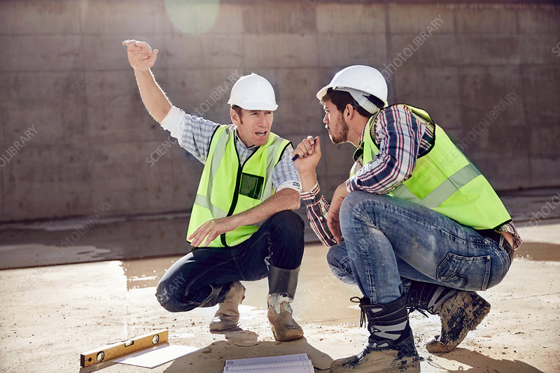 Construction worker and engineer talking