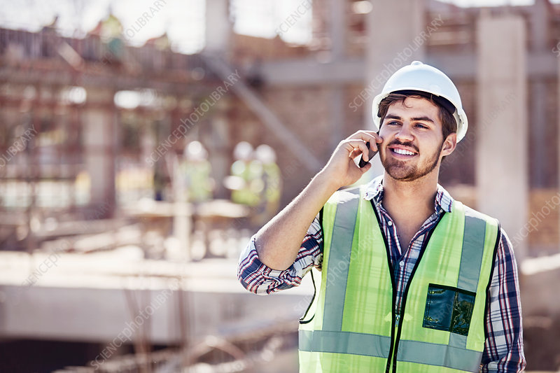 Construction worker talking on cell phone