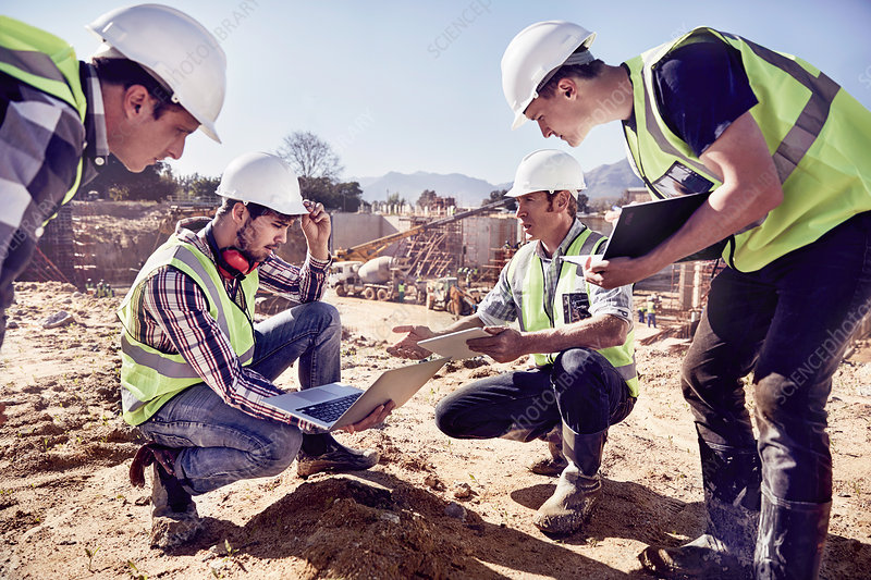 Construction workers and engineers using tablets