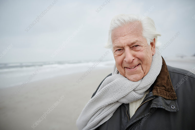 Portrait senior man wearing scarf on winter beach