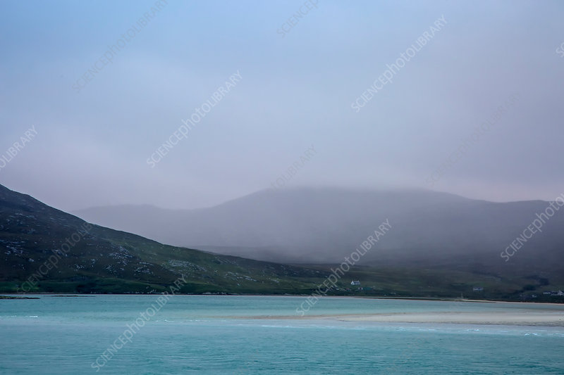Fog over mountains and ocean, Hebrides, Scotland