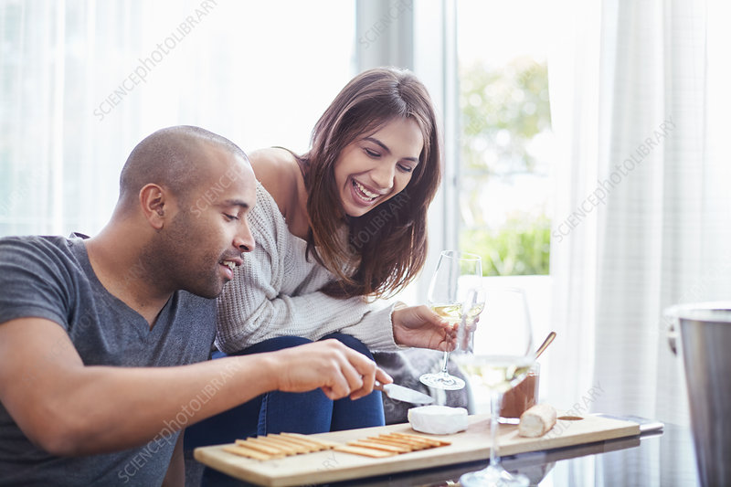 Couple drinking wine and eating cheese