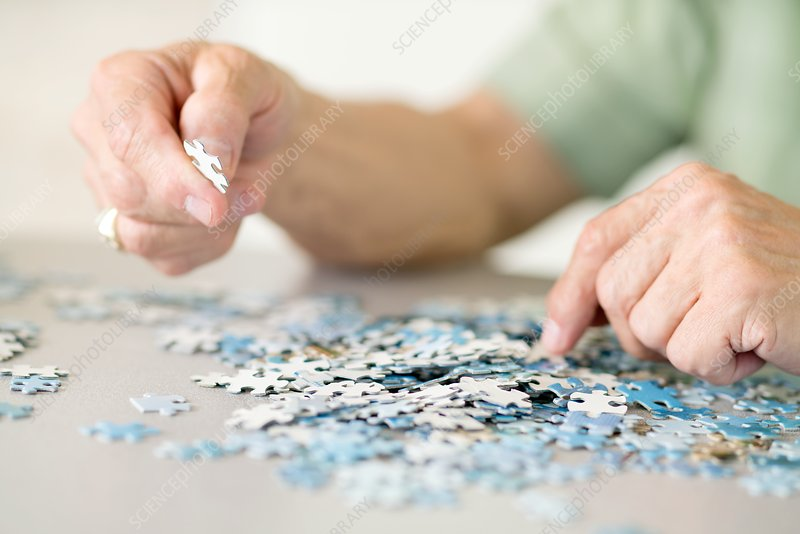 Senior man doing a jigsaw puzzle