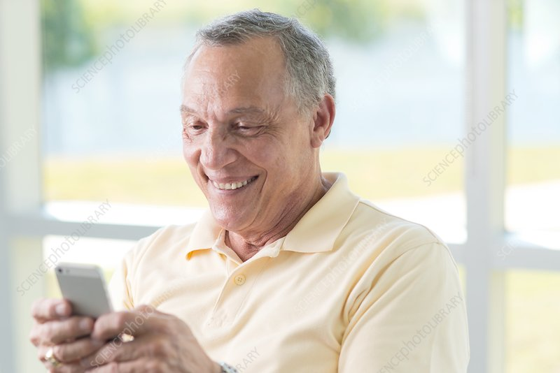 Senior man using cell phone