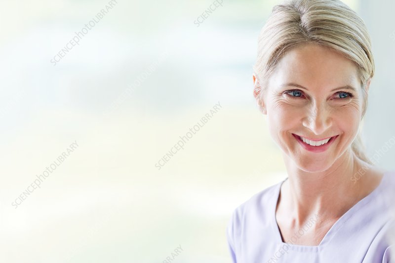 Mature woman with blonde hair smiling