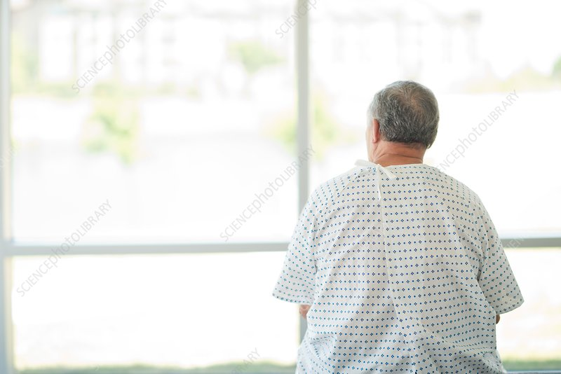 Male patient looking through window
