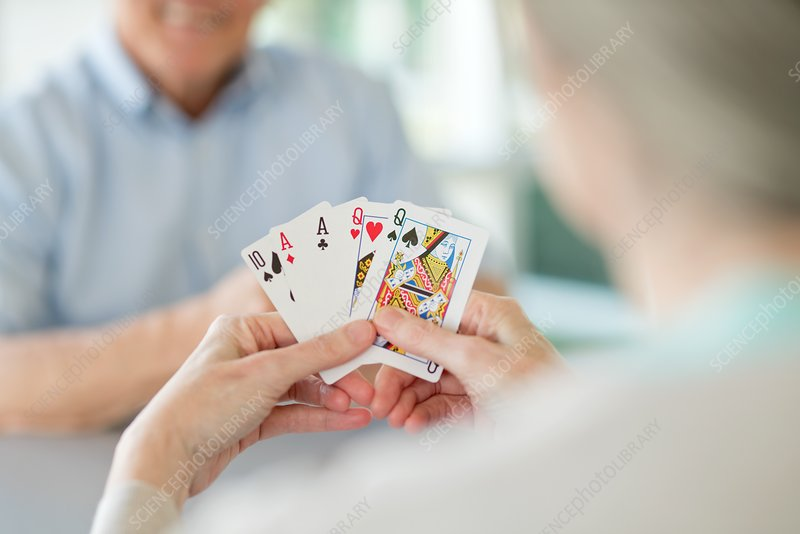Senior couple playing cards