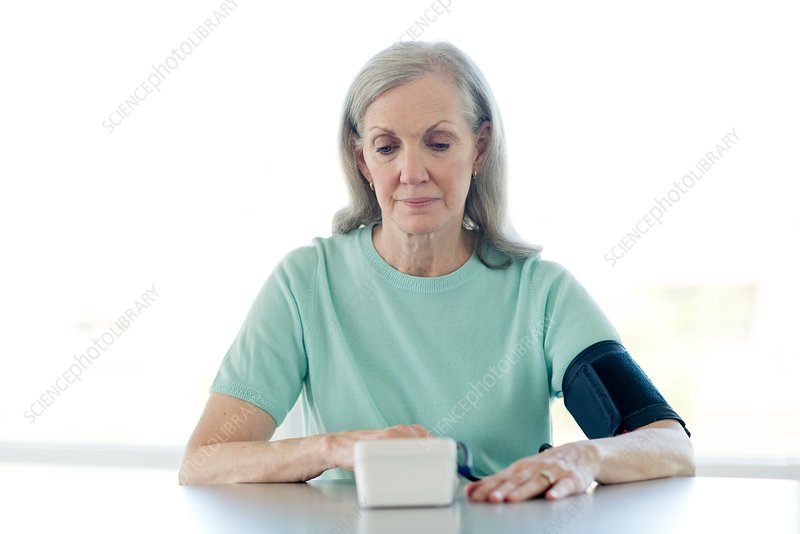 Senior woman taking her own blood pressure