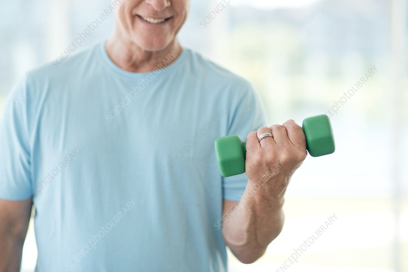 Senior man using weights