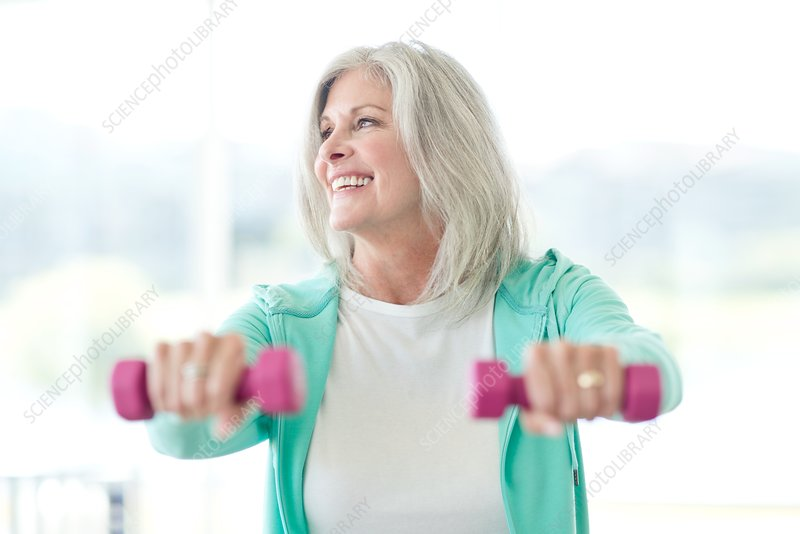 Senior woman using weights