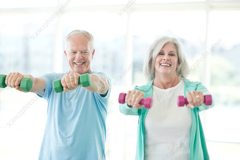 Senior couple using hand weights