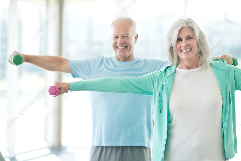 Senior couple using weights
