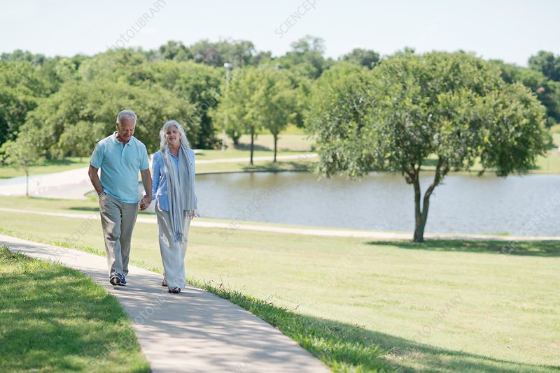 Senior couple walking on path