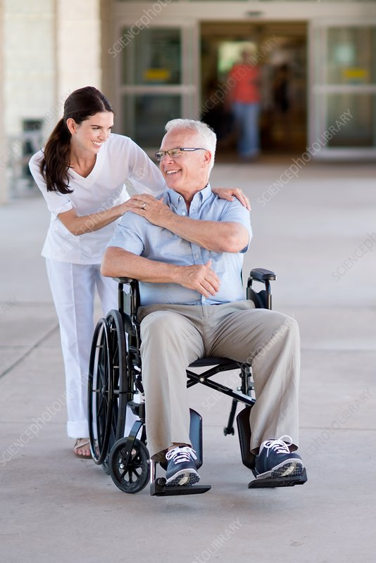 Senior man in wheelchair with care worker